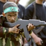 A Palestinian boy takes part in military training organized by the Hamas education ministry in Gaza City